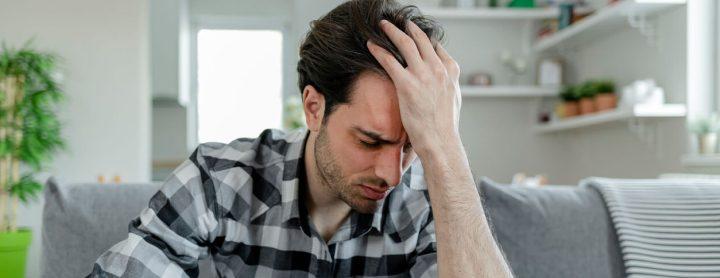 Man experiencing a painful headache