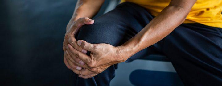Man feeling pain in knee