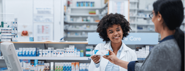 Pharmacist explaining drug label to customer