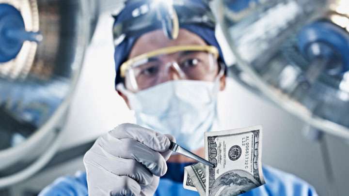 Hernia mesh surgeon holding money