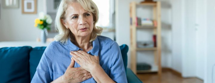 Woman with pain in her chest