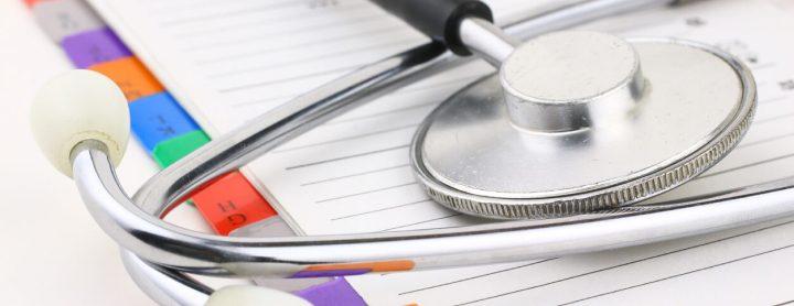 Medical file folder under stethoscope