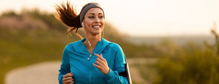 Woman runs while listening to music