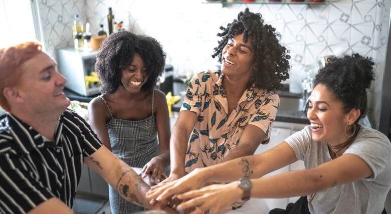 LGBTQ+ friends putting hands together for unity