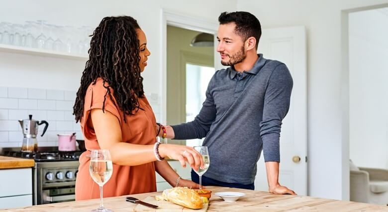 Transgender male with his wife at breakfast table in kitchen
