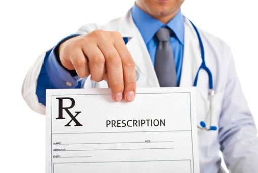 doctor holding up a prescription sheet