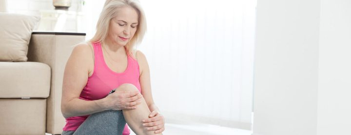 Woman feeling pain in her knee while working out