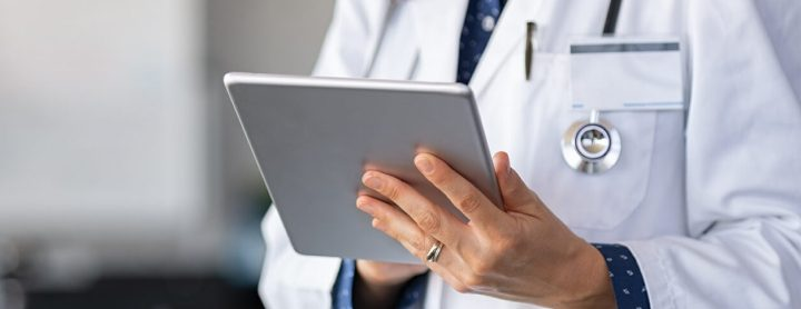 Doctor using tablet