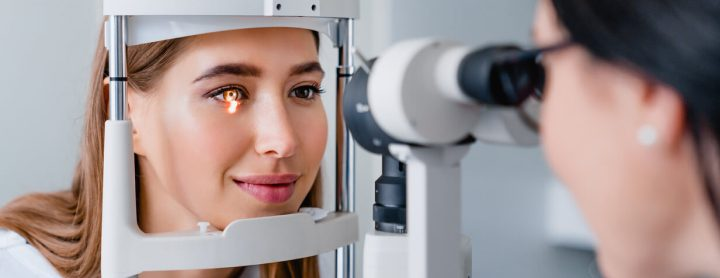 Woman receiving eye exam from doctor