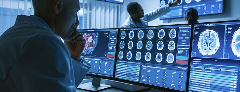 Doctor viewing brain scans on computer