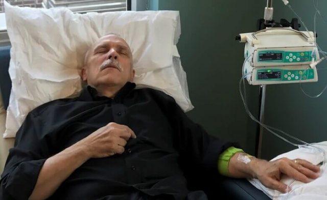 David Mitchell receiving IV treatment