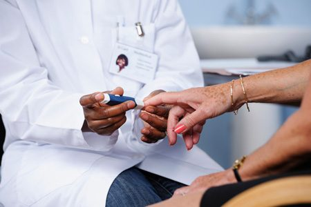 Older Woman's Blood Sugar Being Tested