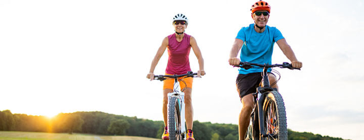 Adult couple biking together