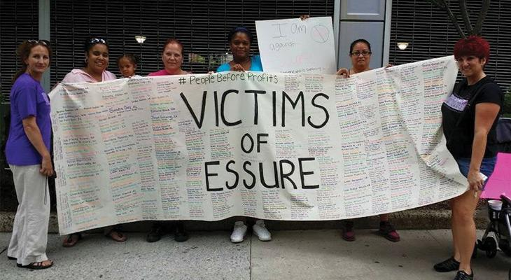 Essure victims hold sign