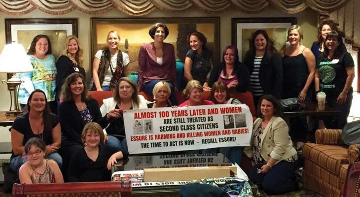 large group of women protesting Essure in a living room