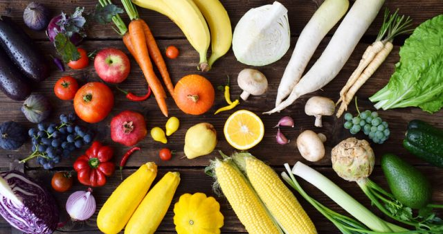 Fruits and vegetables laid out on table