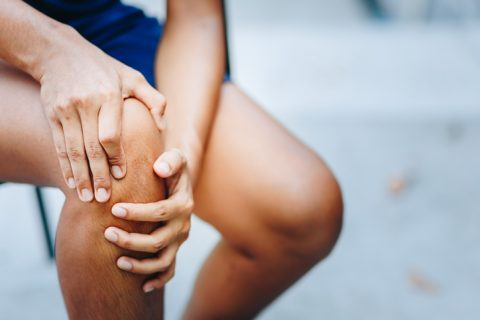 Young woman with knee pain