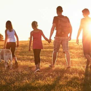 Family walking together during sunset