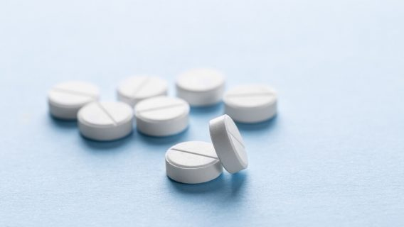 Generic pills scattered on surface