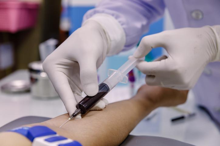 Nurse taking a patient's blood