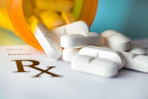 Pills spilling out of prescription bottle