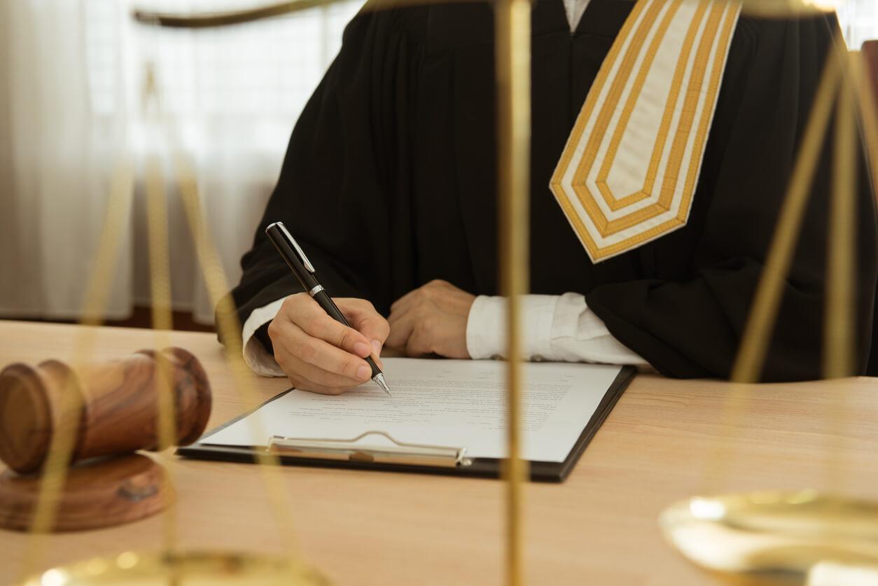 Judge signing document
