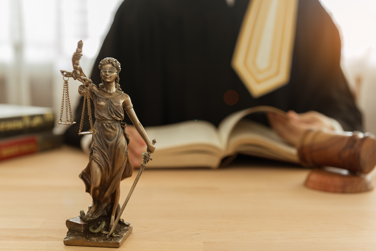 Statue of justice with judge and gavel