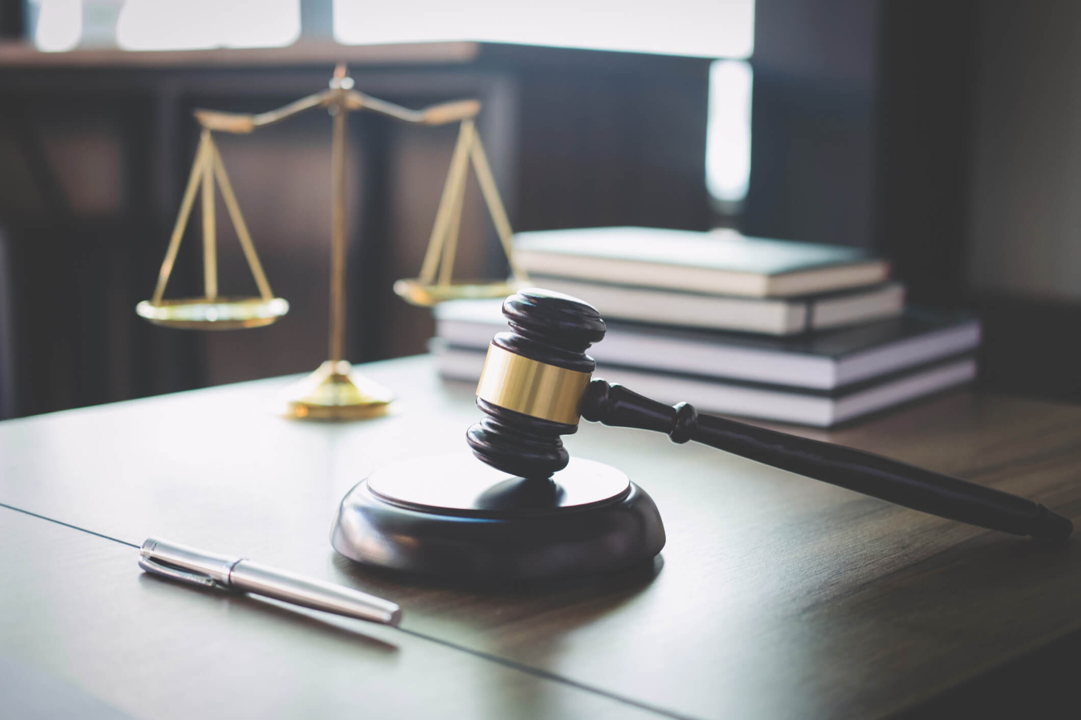 gavel, pen and scales of justice