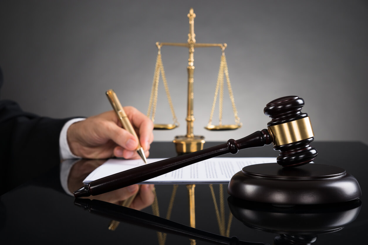 businessman signing settlement document