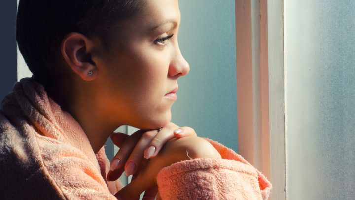 Young female patient staring out of window