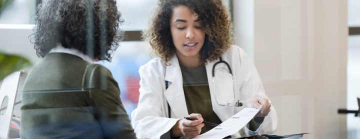 Woman consulting with doctor about medical results