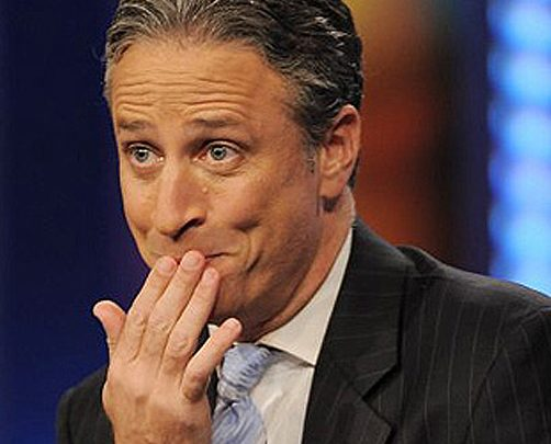 Jon Stewart of The Daily Show laughing
