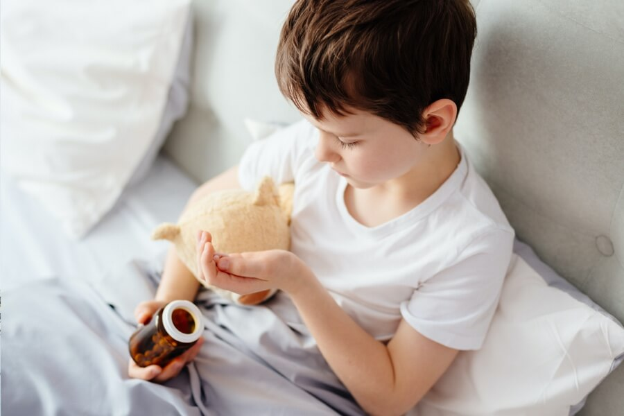 boy holding pills