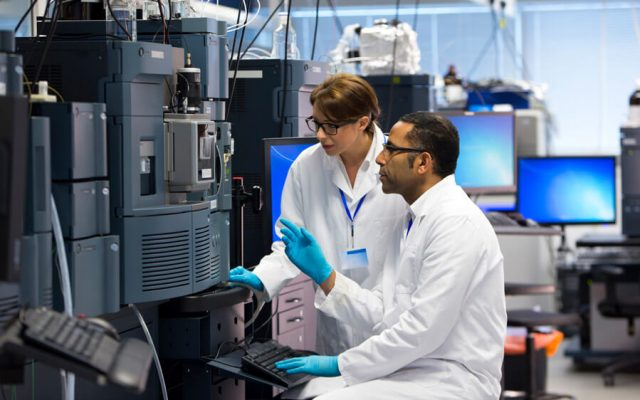 Researchers testing drugs in laboratory