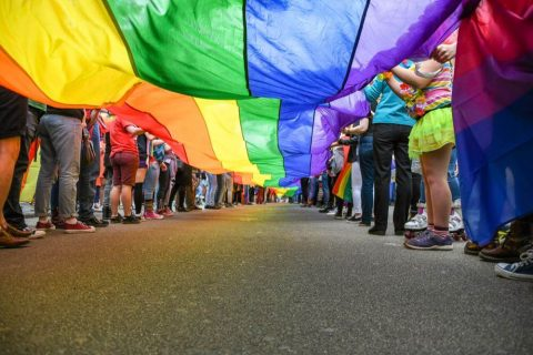 lgbtq+ group holding a rainbow flag