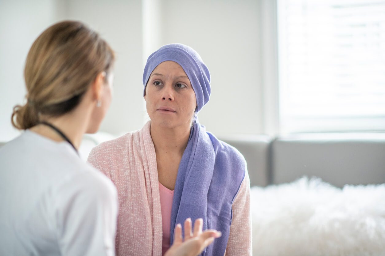 Cancer patient talking to caretaker
