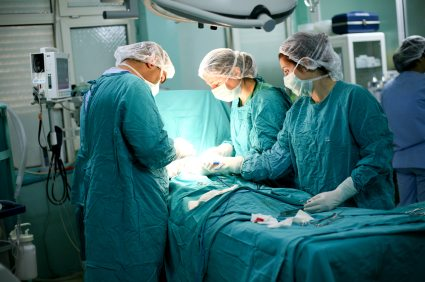 doctors performing surgery on a small patient
