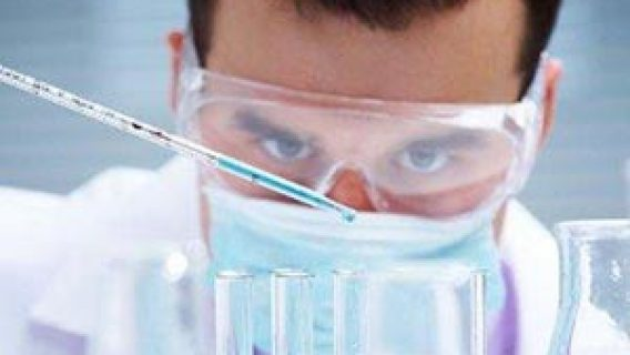 man working in lab with test tubes