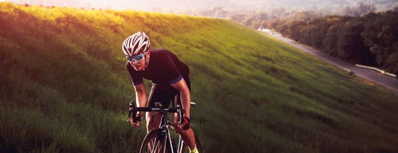 Male bicycling outdoors