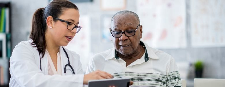 elderly man consulting a doctor