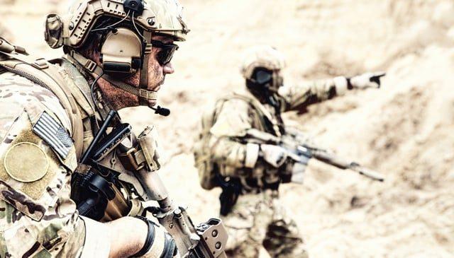 Two military men in the desert