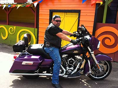 Don Dupuis, a hip implant recipient, on his motorcycle