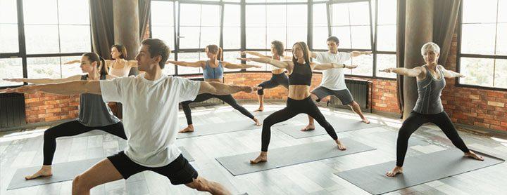 Men and women doing yoga in a studio