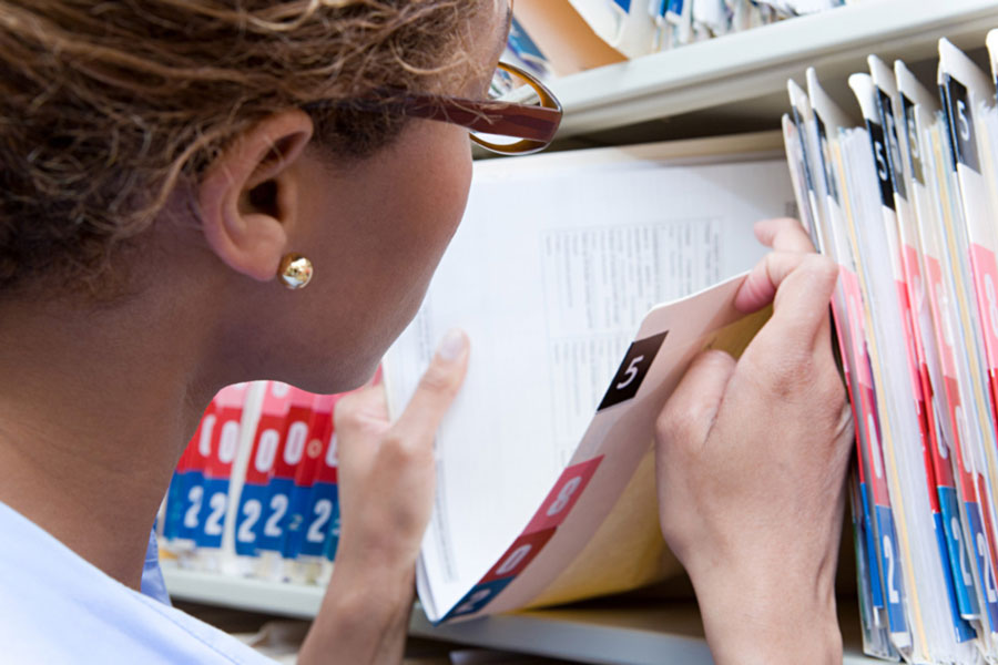 woman looking at a file