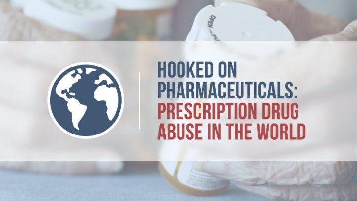 elderly hands holding prescription pill bottles