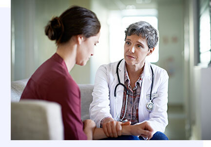 woman explaining her symptoms