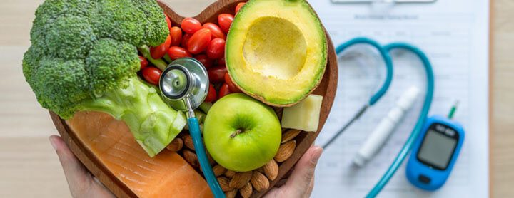 Heart shaped bowl of fruit and a stethoscope