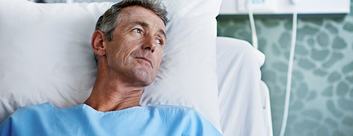Older man resting in hospital bed