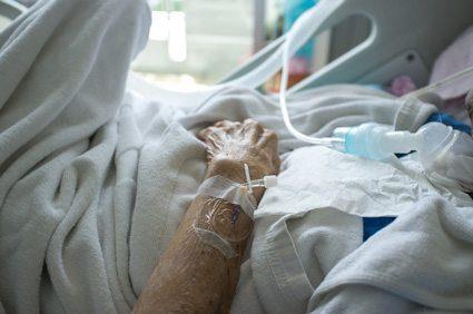Elderly Patient in Hospital Bed