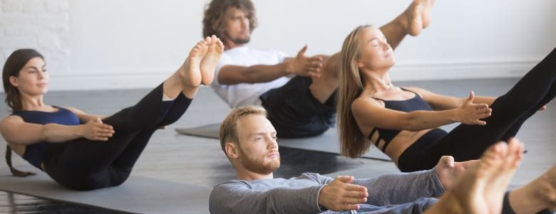 people participating in yoga class